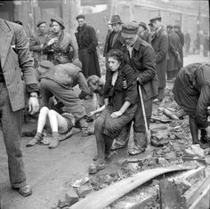 WW2: Soviet slave laborers are rescued from a cellar after it had been locked and set on fire by a German policeman following the liberation of the city by the British VIII Corps, Second Army. Osnabrück, Lower Saxony, Germany. 7 April 1945.