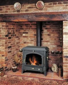 Euroheat has closed Corner Wood Stove, Wood Stove Hearth, Wood Burner Fireplace, Inglenook Fireplace, Cottage Fireplace, Small Fireplace, Rustic Fireplaces, Fireplace Design, House Extension Design
