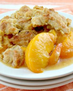 The Best Southern Peach Cobbler! Loaded with juicy,fresh peaches with just the right amount of spices,and the perfect cakey topping with crisp,sugary edges! #Southern #Peach #Cobbler #OldFashioned #Homemade #Easy #Crust #Fresh #Cinnamon #Holidays #Parties #Family #Baking #Fruit #Summer #Cooking #Simple #SweetTreats #Ovens #Crisp