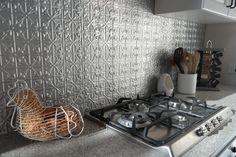Pressed metal spashback (tin backsplash) for our kitchen.