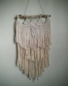 Check out this item in my Etsy shop https://www.etsy.com/listing/250277910/macrame-textured-wall-hanging-knotted