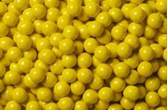 Delicious candy shell with a creamy chocolate center in golden yellow color. Chocolate Pearls, Chocolate Shells, Yellow Candy, Colorful Candy, Sixlets Candy, Hard Candy Concealer, Hard Candy Primer, Candy Film