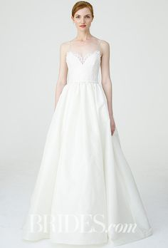 "Brides.com: . ""Carey"" corded lace spaghetti strap bodice and taffeta ballgown skirt with pockets, Nouvelle Amsale"
