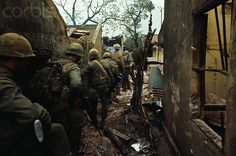 https://flic.kr/p/6F2Seu | U1584034-10 | 17 Feb 1968, Hue, South Vietnam --- U.S. Marines, seen from behind, sneaking between destroyed houses in a village. --- Image by © Bettmann/CORBIS