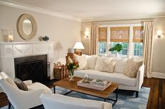 Love the neutrals with the blue rug