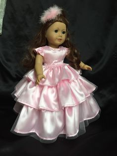 Very pretty pink satin and tulle dress will fit most 18 inch dolls including American Girl. Includes: dress, bloomers and hair piece. Much attention is given to detail, all seams are nicely finished and serged. There is a Velcro closure in the back of the dress. Totally handmade in my smoke free home. Doll is not included.
