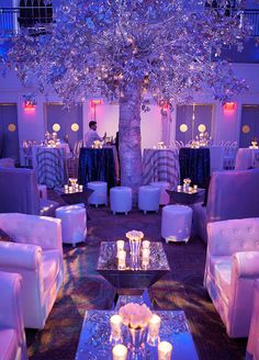 The cobalt blue, snow white, and warm ecru color palette paired with fresh pine garlands, a festive silver tree, and every type of white tulip imaginable were the perfect ingredients needed to create this magical evening.