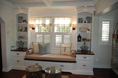 Window seat with bookcases and storage drawers!