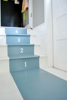 a small staircase right off of the kitchen that leads to an exterior door. ... to dress up the stairs without spending a ton... used Benjamin Moore's porch and floor paint (in White Dove and Van Cortland Blue) along with a stencil