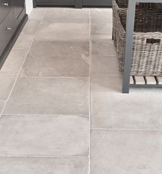 Lulworth sandstone in a seasoned finish from Artisans of Devizes. Natural stone floor tiles are ideal for kitchens.