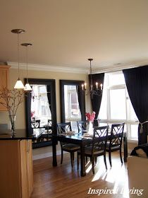 two large thick-framed vertical mirrors in dining room (or living room)