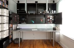 I designed this desk to get all my computer equipment and cables up off the floor, behind cabinet doors, and leave my work surface completely clear. A major part of this project was also incorporating the analog meters which show my computer's status