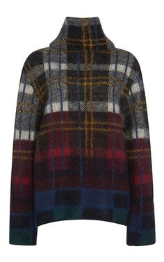 This **Suno** plaid pullover features a relaxed turtleneck and an all over plaid…