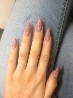 Oval shaped long acrylic nude nails