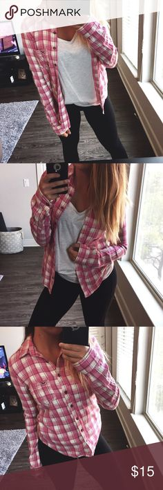 HOLLISTER // Pink Plaid Flannel Pink plaid flannel from Hollister. Great condition. Fits more like XS. Hollister Tops Button Down Shirts