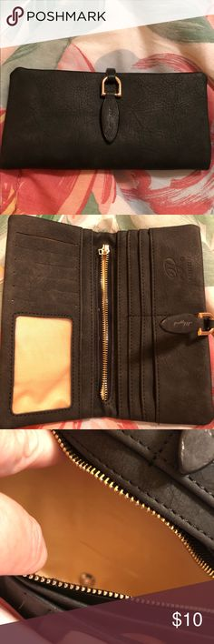 Prettyzys Women Nubuck Leather Wallet This black leather wallet has numerous credit card slots, a place for your license and spacious change purse. Prettyzys Bags Wallets