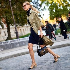 Trench over a turtleneck dress with Chanel slingbacks.
