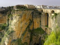 Hotel Parador de Ronda, Spain On the edge of the Ronda Gorge is a hotel with an amazing view. The former city center, Parador de Ronda, is only a stones throw away from the beautiful chasm, which can be seen from the hotel room. Places Around The World, Oh The Places You'll Go, Places To Travel, Places To Visit, Around The Worlds, Hidden Places, Beautiful Hotels, Beautiful Places, Amazing Hotels
