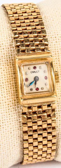 """Lot 95 in the 9.1.15 online & live auction! Lovely 14kt yellow gold vintage ladies """"Chalet"""" wrist watch with link style band. Face of watch marked """"Chalet"""" with red and clear colored stones. Marked """"14k"""", measures: 6.25"""" long. Total weight: 14.2 dwt. #Jewelry #Fashion #Shopping #POGAuctions"""