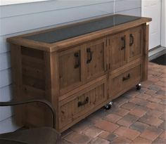 Custom Outdoor Cabinet, Rustic Cooler Bar Cart, Grilling Prep Table, Sideboard or Buffet to use as flexible Patio Furniture - All About Gardens Outdoor Buffet Tables, Outdoor Bar Cart, Outdoor Ideas, Rustic Outdoor, Patio Ideas, Backyard Ideas, Sunroom Ideas, Backyard Projects, Backyard Patio