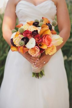 This bride's bouquet reminds us of a yummy bowl of fruit! Photography by loveisabigdeal.com, Event & Floral Design by cedarwoodweddings.com