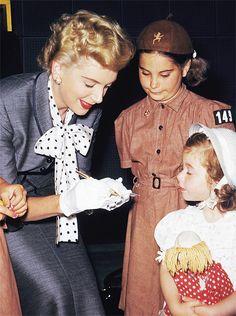 Deborah Kerr signing autographs:)