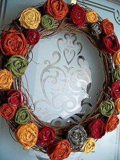 Fall wreath-like the use of rolled fabric in this