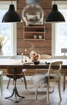 Wooden dining room in a cosy Norwegian home in the country.