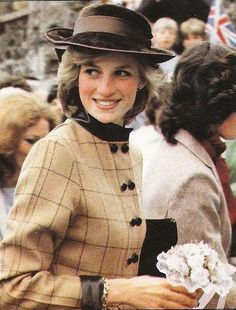 On March 9, 1983 Diana visited the market town of Tavistock in West Devon. During the visit to the West Country the princess also visited two playgroups for children under five, at Bovey Tracey and Tavistock. Diana wore a tan colored checked wool coatdress with chocolate brown leather collar and cuffs by designer Arabella Pollen. Her hat was a dark brown  suede.