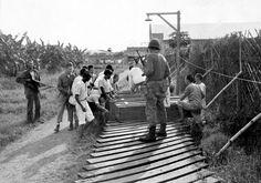 Japanese prisoners, that surrendered to the Americans, bury the dead at Santo Tomas, Manila, Philippines. Palawan, O Donnell, World History, World War Ii, University Of Santo Tomas, Nagasaki, Hiroshima, Filipino Culture, Leyte
