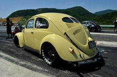 """VW vintage split window bug!  Dragging with """"W"""" convertible decklid, (better cooling!) Pope's nose, and Heart tail lights!  Now, that's Cool!"""