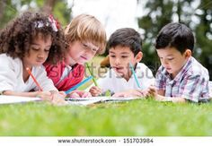 Group of school kids coloring outdoors looking happy  - stock photo