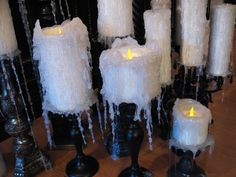 DIY PVC Pipe & Hot Glue Candles (uses battery-operated tea lights inside) - great & inexpensive way to get a lot of candles for Halloween - detailed tutorial (with video) from How to Haunt Your House
