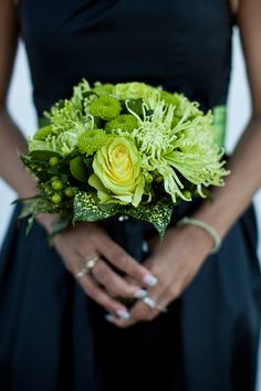 Green bridesmaid bouquet with spider mums, roses, kermit mums, hypericum berries finished off with a collar of florida beauty leaves