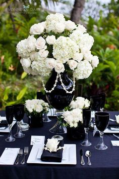 White roses and hydrangeas in a black urn accented with pearls!