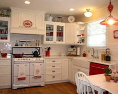LOVE LOVE this color scheme for a kitchen, clean white with red accents looks so fresh!