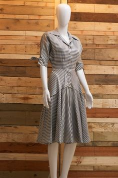This is wonderful. It is such a good strong hard wearing yet attractive fabric. Shiney with duck egg blue stripes on the grey/silver fabric.
