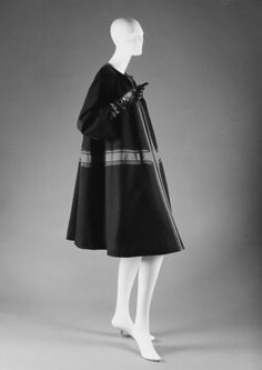 Coat  by:House of Dior (a French designer,founded 1947) ~Designer: Christian Dior (French,Granville 1905–1957 Montecatini)  ~Date:1953 ~Culture:French ~Medium:wool ~Dimensions: Length@center back 41¼ in. (104.8 cm) ~Credit Line: Gift of Barbara Barondess MacLean,in 1996