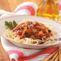 "Vegetarian Pasta Sauce Recipe -Loaded with fresh vegetables and herbs, this hearty, meatless sauce is a perfect way for gardeners to make delicious use of their harvest. ""You can add some of your favorite red wine to the sauce during the cooking process, if you wish."" —Jerry Tamburino Sacramento, California"