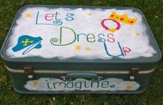 Old suitcase into Dress Up box. Super easy & fun! The outside decoration isn't my fav, but I like the idea of all the dress up clothes being contained.