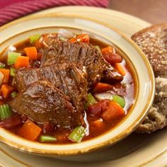 4 pounds boneless beef chuck roast 1/2 teaspoon salt 1/4 teaspoon ground black pepper 2 tablespoons Pure Wesson® Vegetable Oil 1 large onion, chopped (1 large = about 1 cup) 1 large carrot, chopped (1 large = about 2/3 cup) 2/3 cup chopped celery 2 cans (14.5 oz each) Hunt's® Diced Tomatoes with Basil, Garlic & Oregano, undrained 1 can (14 oz each) beef broth