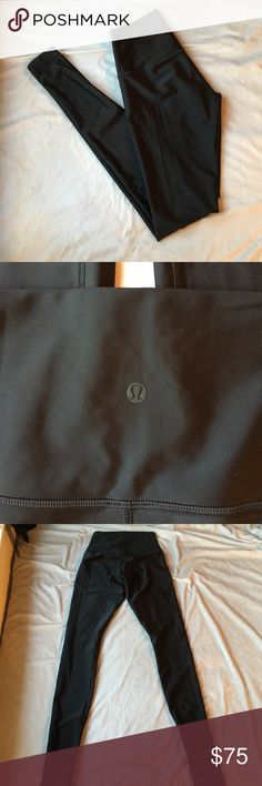 Shiny black high rise Lululemon leggings These are gorgeous shiny high rise Lululemon leggings with a black brand dot, these are very rare and hard to find special editions! I ❤️ offers! lululemon athletica Pants Leggings