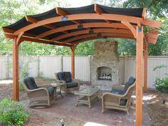 Pergola, hardscape, and outdoor fireplace