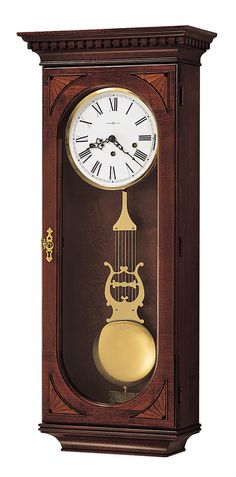 Lewis Wall Clock. This stunning wall clock has beautiful gold accents that will catch the light in any room. - Key-wound, triple-chime Kieninger movement plays choice of Westminster, St. Michael, or Whittington 1/4, 1/2, and 3/4 chimes accordingly with full chime and strike on the hour. - An industry exclusive dual-ratchet winding arbor ensures safe movement winding. - Chime silence option and durable bronze bushings  - Locking door for added security. - Designed and Assembled in the USA.