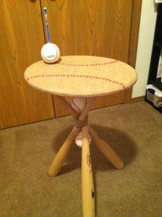 I want to make this for Austin's classroom!!  From the original Pinner: I used three baseball bats, three baseballs, one wooden circle (or oval, because that's all I could find :)) Burlap and a Hot Glue Gun!!!  You can do wonders!  The table top is covered in burlap and I used a red marker to draw the baseball stitching. I also glued a baseball with a hole drilled through it for a pencil holder.