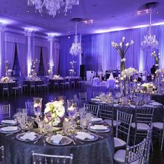 Jayme & Andy were married in the bride's hometown of Chicago. The ballroom was awash in vibrant, violet lighting. (via KingenSmith)
