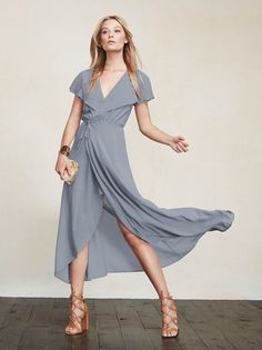The Harwood Dress is great for summer weddings, brunch, or pretty much any other occasion you can throw at it. It's a full length georgette maxi dress with a plunging neckline, wrap skirt and cape sleeves that go all the way around the back. The waist is fitted but the skirt goes full with just enough leg room. You'll wanna take her everywhere. Made from 100% viscose.