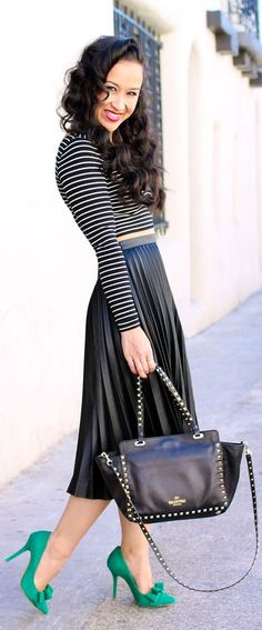 Black & white stripes crop top, leather pleated midi skirt, green bow pumps, studded bag.