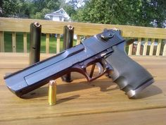 """""""The Desert Eagle"""" was originally designed by Bernard C. White of Magnum Research, who filed a US patent application for a mechanism for a gas-actuated pistol in January 1983. This established the basic layout of the Desert Eagle. A second patent application was filed in December 1985, after the basic design had been refined by IMI (Israel Military Industries) for production"""