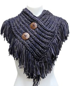 A gloriously chunky, textured cable knit infinity scarf featuring stylish hand made coconut buttons Wildly warm and super fun Great quality and craftsmanship It feels really cozy and warm, one of the More
